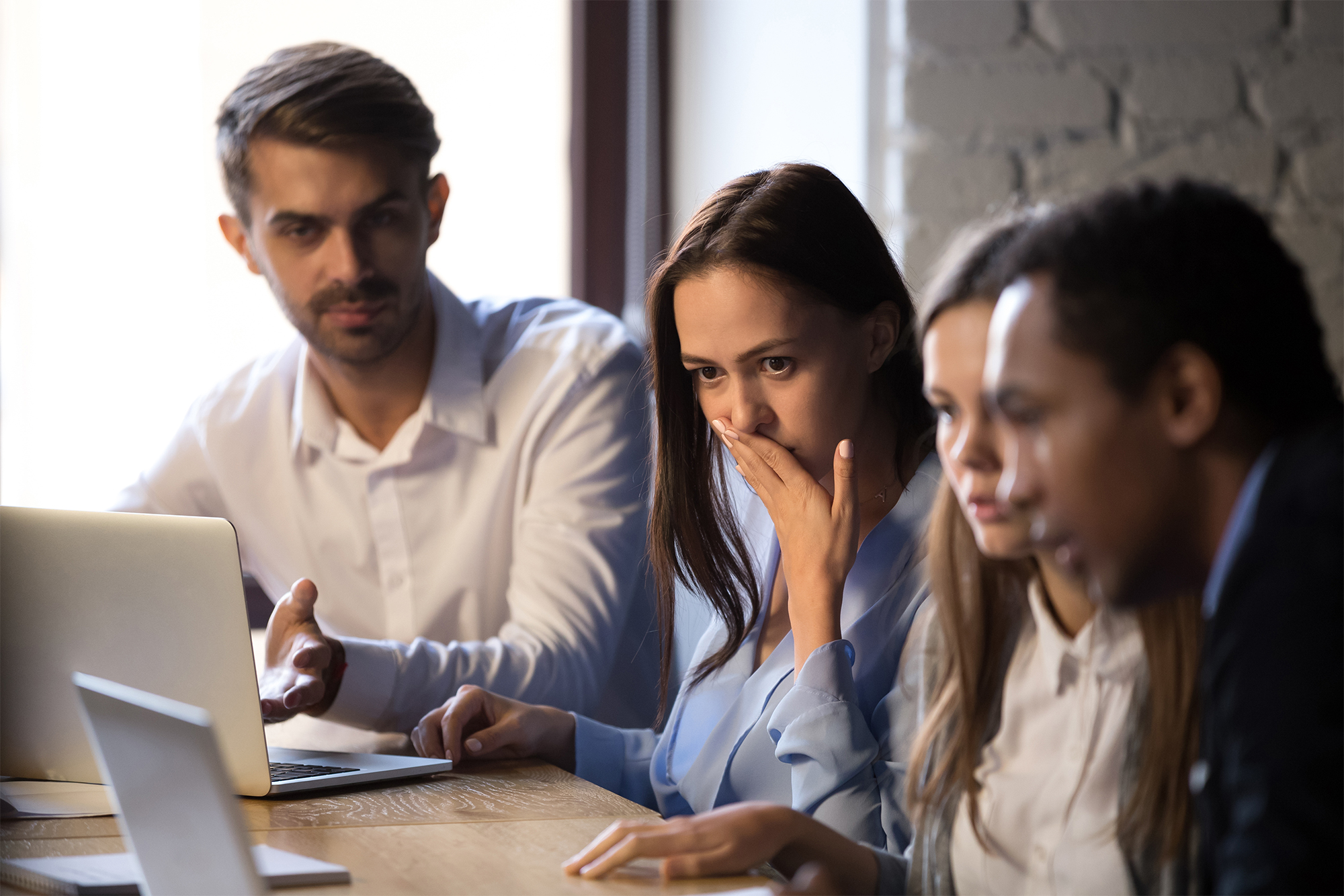 Group of coworkers receiving bad news